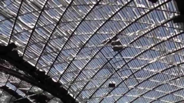 """1897 - World's First Gridshell by Vladimir Shukhov : """"Vyksa Steel Production Hall, completed in: 1897 Location: Vyksa, Nizhny Novgorod Oblast, Privolzhsky (Volga) Federal District, Russia Structural Type: Gridshell Function / usage: Factory building Designer: Vladimir Grigoryevich Shukhov  Technical information: shell, steel Dimensions: width - 38.40 m, length - 73.00 m Relevant Literature: Beckh, Matthias The First Doubly Curved Gridshell Structure - Shukhovs Building for the Plate Rolling Workshop in Vyksa, presented at Third International Congress on Construction History, Brandenburg University of Technology Cottbus, Germany , 20th-24th May 2009.""""  http://en.structurae.de/structures/data/index.cfm?id=s0051326 http://www.youtube.com/watch?v=iJ0hScrDqXQ """"The First Doubly Curved Gridshell Structure - Shukhov's Building for the Plate Rolling Workshop in Vyksa. In the year 1897, the renowned Russian engineer-polymath Vladimir Shukhov built a production hall in the town of Vyksa, a steel mill 150km southwest of Nizhny Novgorod. This building entails the first doubly curved gridshell structure. ... The production hall is on the vast premises of the Vyksa Steel Works, a manufacturer of metallurgical products, founded in 1757. The building was designed in 1897 and construction could be completed a year later. The building was in use until the 1980ies. Abandoned and neglected for more than two decades, the building is today in a disastrous state of repair. The construction with a footprint of 73.00m x 38.40m consists of five 14.60m wide bays, which are separated by four trussed arches. In the longitudinal direction, the building is braced by six vertical cantilevers, which are integrated into the front facades, and connected to the arches with tie rods. The polygonal top chord of the frames provides the base for the grid shell. In the following, the construction of the arches and the front facade structure will be explicated."""" Matthias Beckh, Rainer Barthel TU München, Mun"""