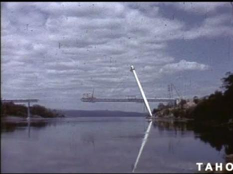 Batman Bridge (1969) : The history and construction of the Batman Bridge, Tasmania.  On the 24th of April 1964, the Government issued its' first press release for the signing of a tender for the building of the Batman Bridge. This film features John Crook interviewing Minister for Lands and Works Mr D.A. Cashion, Public Works Director Mr R.C. Sharp, construction footage, interviews with builders and opening of the bridge. A TasFilm Production. Please be advised that this footage may contain words and descriptions that may be culturally sensitive, which reflect the attitude of the period in which the film was produced, and which may be considered inappropriate today. Tasmanian Archive and Heritage Office: Film - Batman Bridge - 16mm colour release print (sound) - 12m 20s - (Reference: AB869/1/275) To view the record for this item on our website click the link below. https://linctas.ent.sirsidynix.net.au/client/en_AU/tas/search/detailnonmodal/ent:$002f$002fARCHIVES_DIGITISED$002f0$002fAB869-1-275/one To search for more films in our archives. https://linctas.ent.sirsidynix.net.au/client/en_AU/tas/?