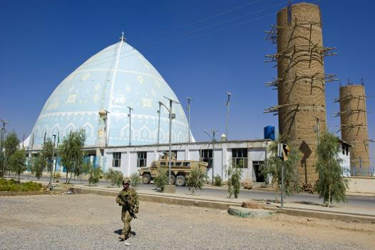 Kandahar University Mosque : A security team member from the Kandahar Provincial Reconstruction Team patrols Kandahar University during a humanitarian mission to supply engineering textbooks to students.
