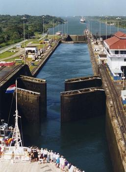 Panama Canal's Gatun Locks gates opening. The ship in the foreground is the Holland-America cruise ship MS Ryndam