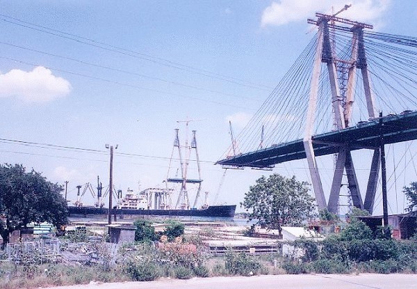 Fred Hartman Bridge under construction Outbound ship passing