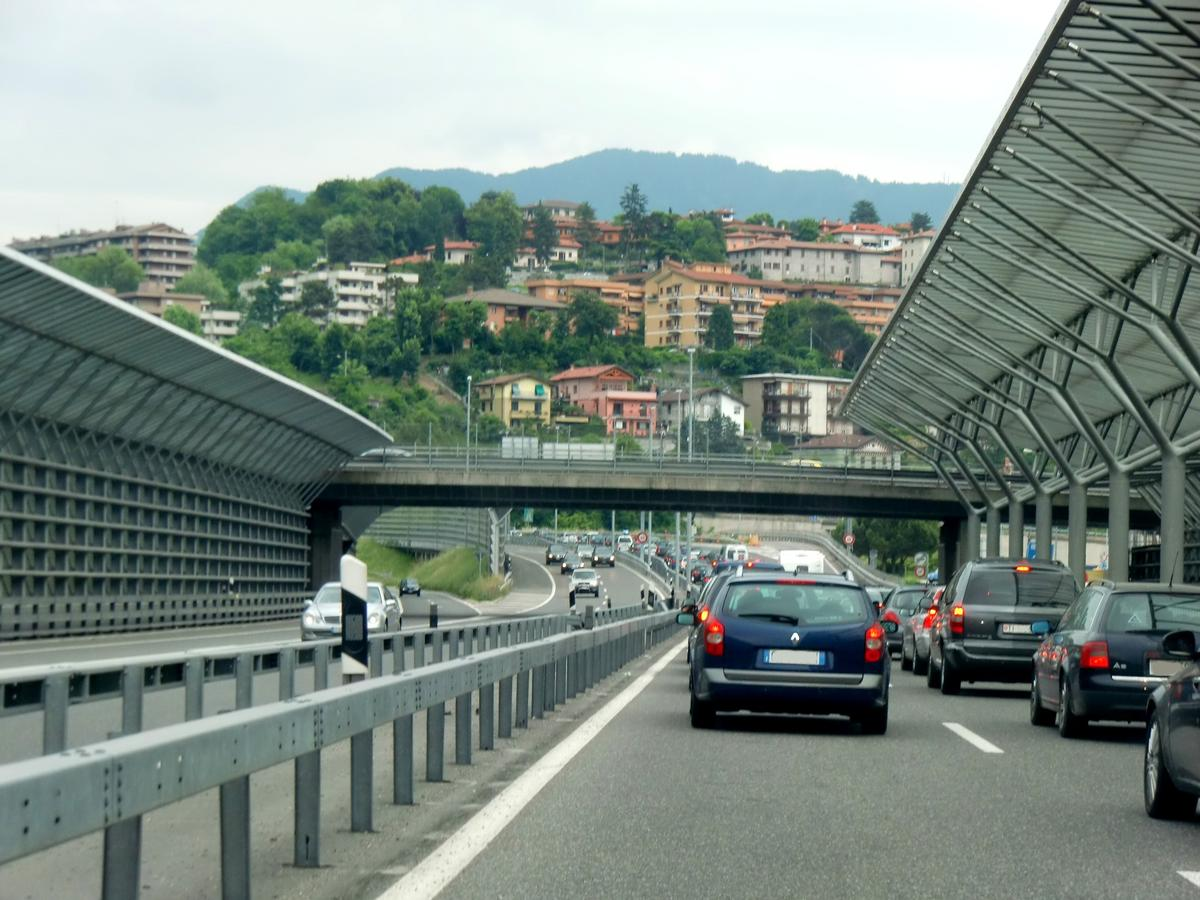 A2 motorway in Chiasso near italian border, with Mario Botta's Trees (noise barriers)