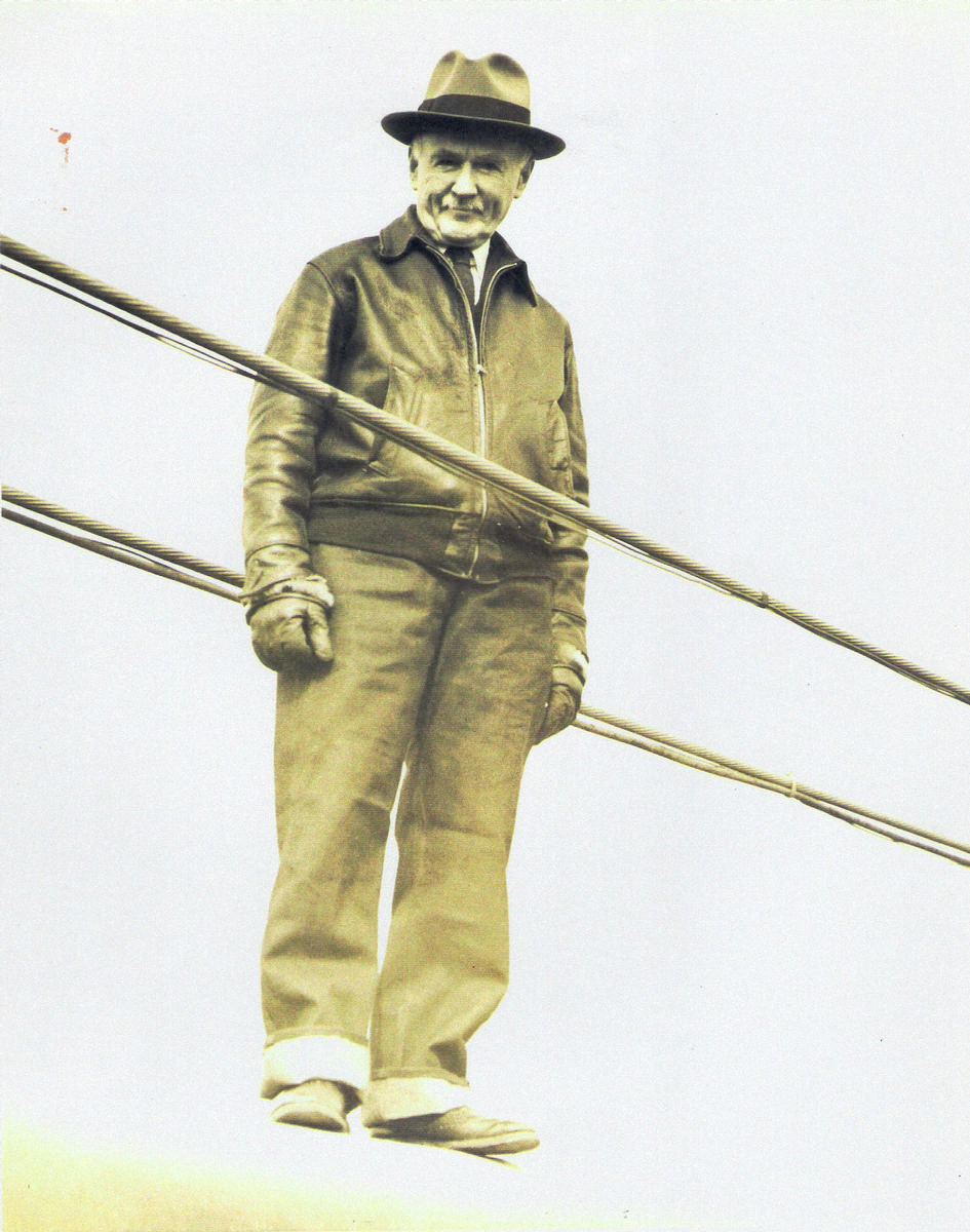 Holton Duncan Robinson at age 78 walking a suspension bridge cable. From the private collection of Ann Robinson Henshaw