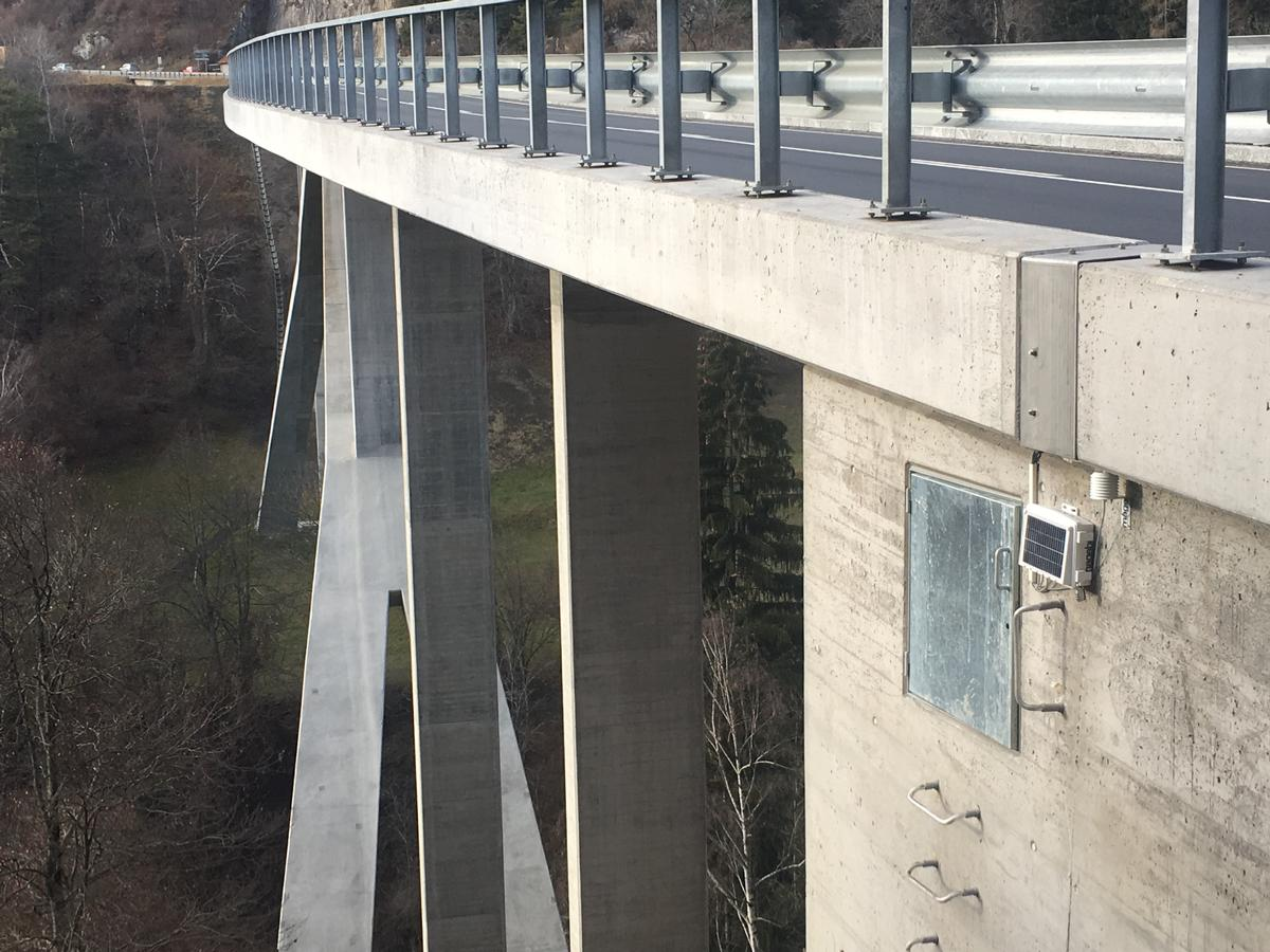 Media File No. 270445 The heart of the SHM system, installed externally at one abutment of the Lavoitobel Bridge, complete with integrated solar panel on its cover for power supply and a separate weather sensor