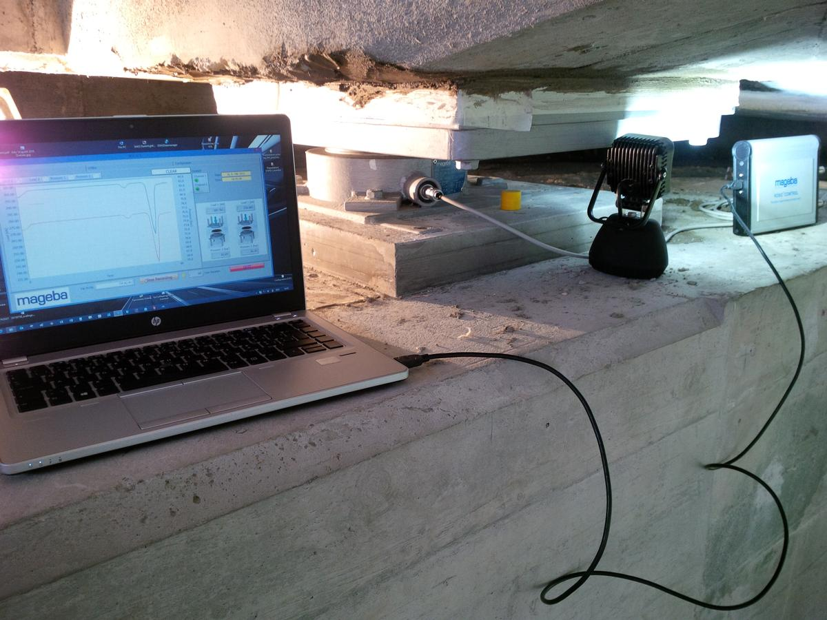 Media File No. 270450 A temporary SHM system requires a portable monitoring device and a laptop or tablet computer to be brought to the structure and connected by cable to the bearing.