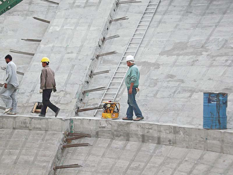 Workers inside a water tank