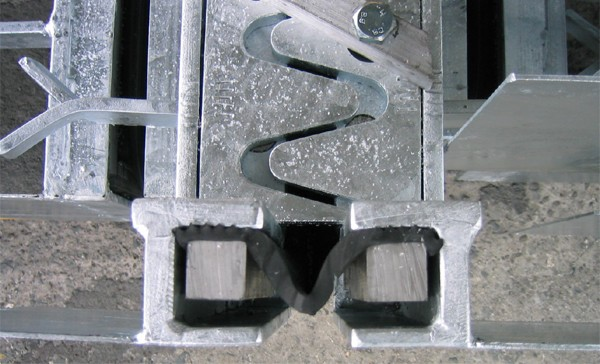 Rubber profile is attached to the edge profile with special clamping strips