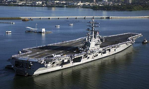 USS Ronald Reagan in front of Admiral Clarey Bridge at Pearl Harbor