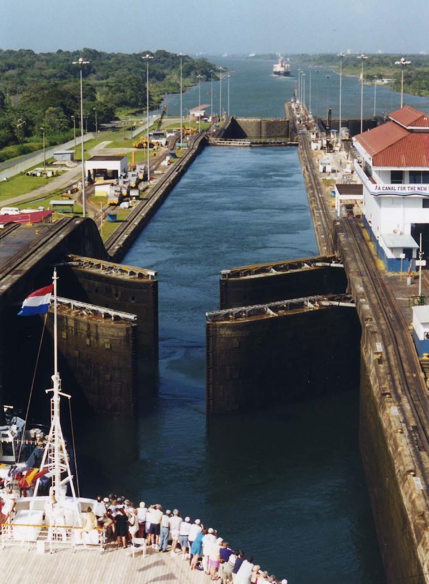 Panama Canal's Gatun Locks gates opening. The ship in the foreground is the Holland-America cruise ship MS Ryndam Panama Canal's Gatun Locks gates opening. The ship in the foreground is the Holland-America cruise ship MS Ryndam