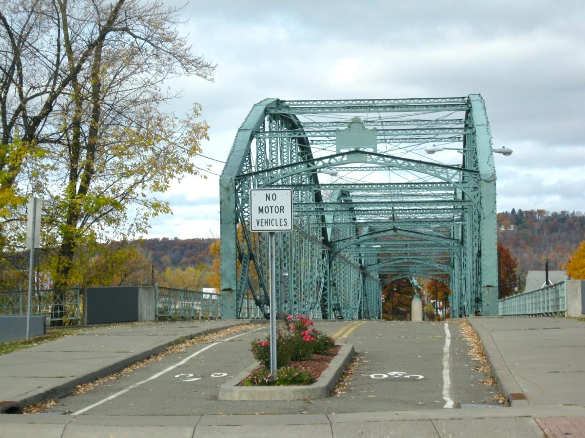 The South Washington Street Parabolic Bridge, in Binghamton, New York The bridge is listed on the U.S. National Register of Historic Places. The bridge was built in 1886 and was closed to motorized traffic in 1969. This is the south end of bridge.